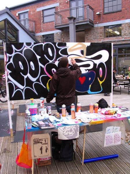 Paris paints his Pop Stop Shop sign